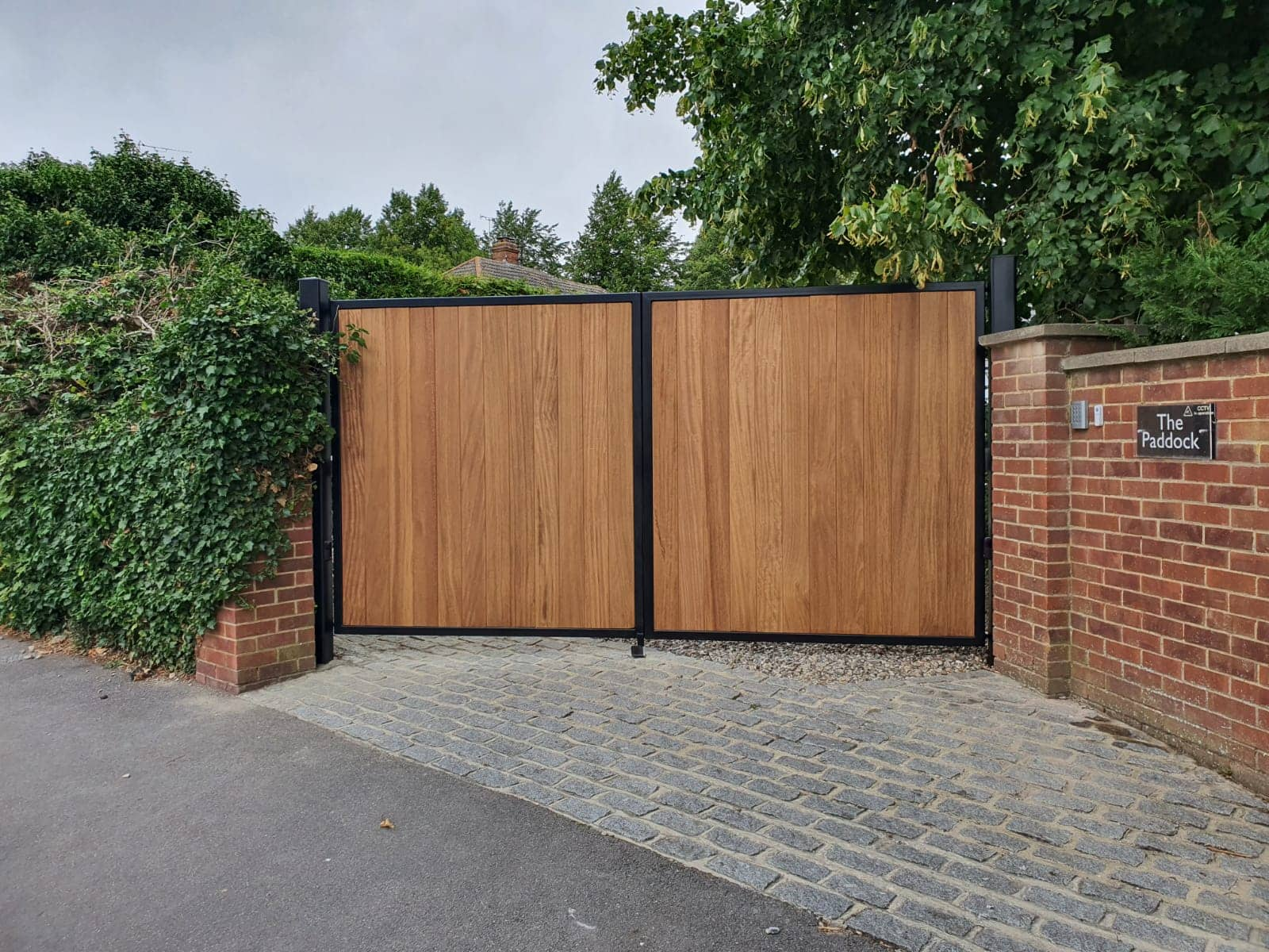 Example installation of custom electric wooden gates by DC Gate Solutions